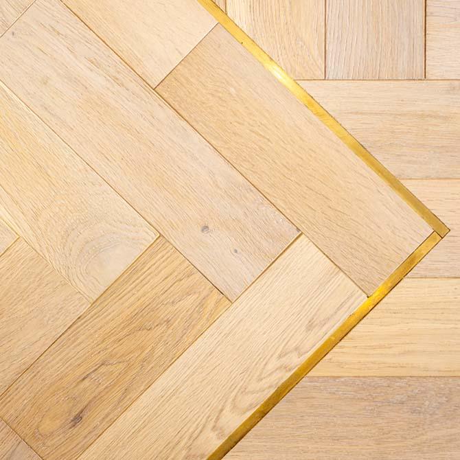 brass design strip for flooring
