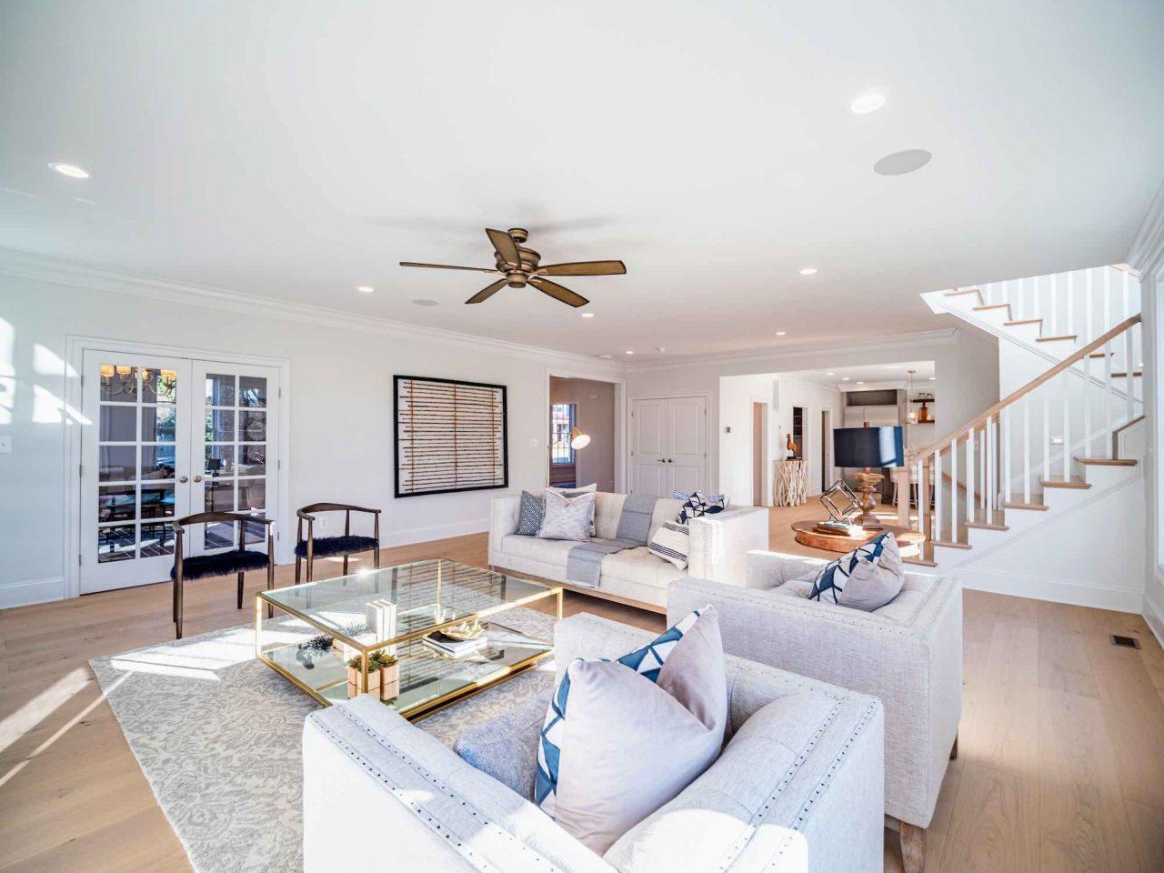 coastal living room with engineered hardwood flooring