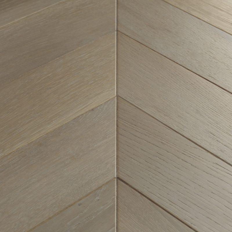 engineered chevron parquet wood flooring in grey tones