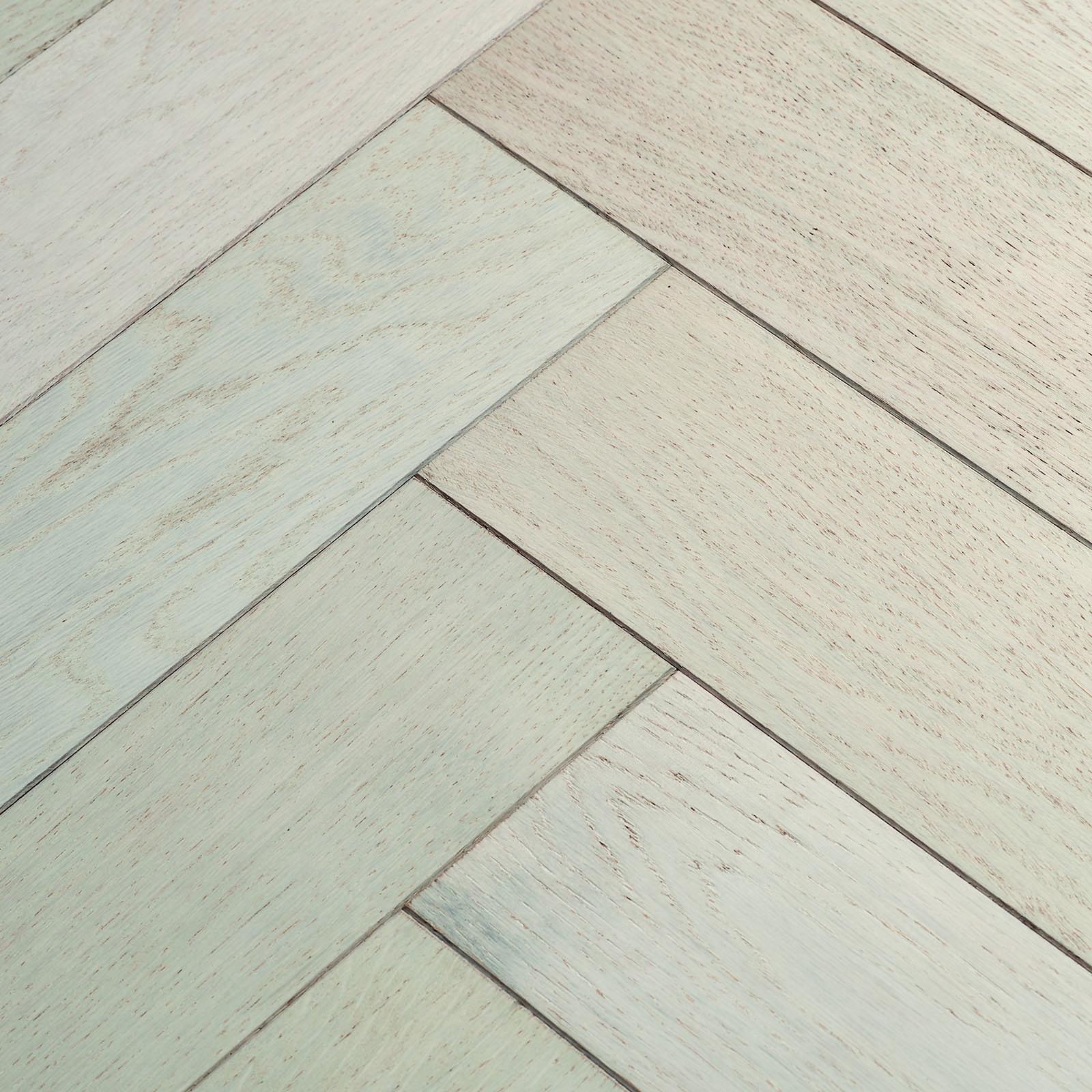 Beautiful engineered white herringbone flooring. Goodrich Cotton Oak