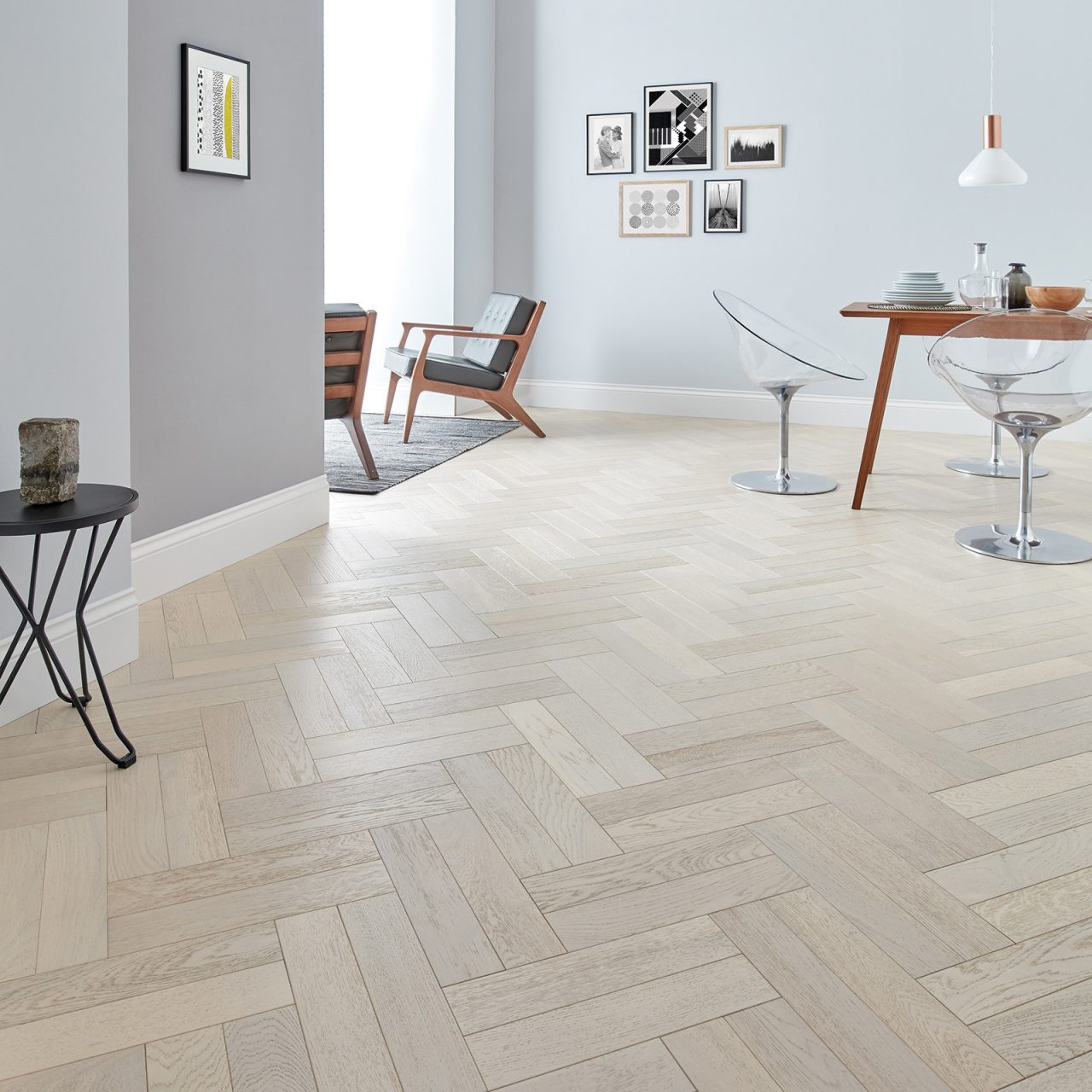 Modern living room with white engineered parquet flooring.