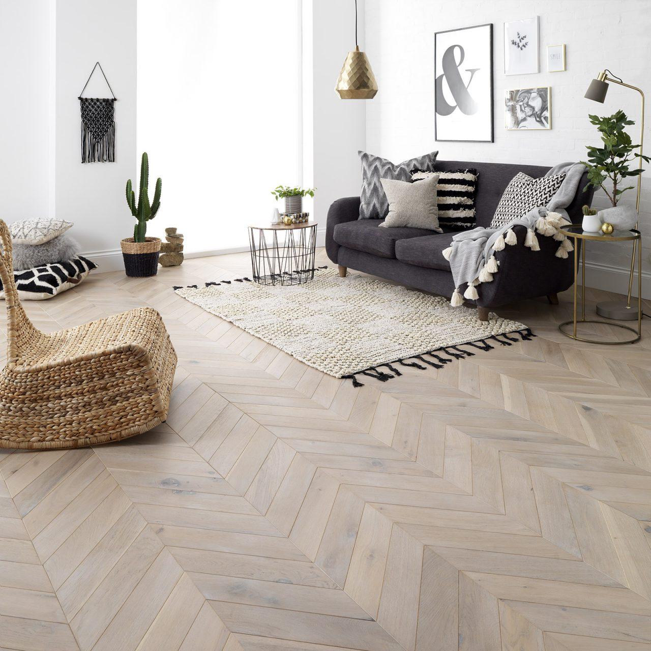 engineered chevron wood flooring. Living room with beautiful greige parquet wood flooring